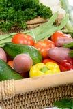 Basket of seasonal vegetables on  wooden table Stock Photo