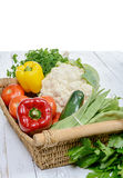 Basket of seasonal vegetables on  wooden table Stock Photography