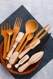 In a basket is a set of wooden kitchen utensils. stock photos