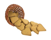 Ginger snap cookies spilling from basket Royalty Free Stock Photos