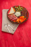Basket with several Spanish tapas on red table Stock Image