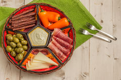 Basket with several Spanish tapas on white table Royalty Free Stock Photography