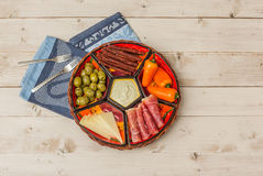 Basket with several Spanish tapas on white table Stock Photography