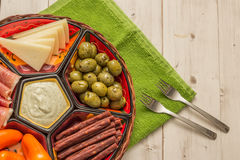 Basket with several Spanish tapas on white table Stock Images