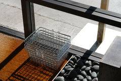 Basket by shop doorway. A stack of wire shopping baskets sits on doormat just inside a shop entrance stock photos