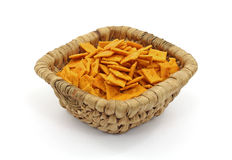 Basket of Small Square Cheese Crackers Royalty Free Stock Image