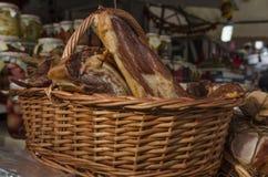 Basket of smoked ham Stock Photography