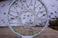 A basket with snow with dog footprint