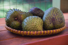 Basket of Soursop Fruit at a Farmstand in Kauai. A close-up shot of a basket of exotic soursop fruit at an outdoor farmstand on the island of Kauai, Hawaii Royalty Free Stock Images