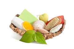 Basket with spa accessories. Palm basket with spa accessories isolated on white background Royalty Free Stock Photos