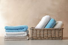 Basket and stack of clean towels stock photos