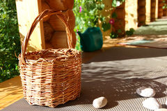 Basket and stones Stock Images