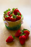Basket of strawberries. With flowers Stock Photo