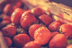 Basket of strawberries. Full basket of red strawberries Royalty Free Stock Photo