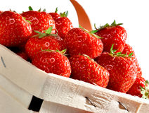 Basket of strawberries on white background Royalty Free Stock Images