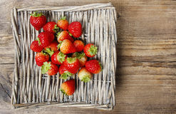 Basket of strawberries on wooden table Royalty Free Stock Images