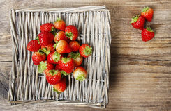 Basket of strawberries on wooden table Royalty Free Stock Photography