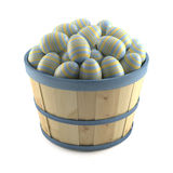 Basket of striped easter eggs. Isolated on white background Stock Photo