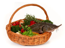 Basket with sturgeon. Still life. Basket with fresh vegetables and sturgeon Royalty Free Stock Photos