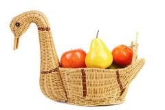 Basket swan with decorative fruits. Royalty Free Stock Image