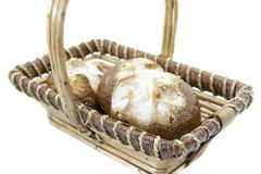 Basket with sweet buns Stock Images