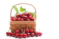 Basket with sweet cherries Stock Image