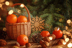 Basket with tangerines, cones, nuts and fir Stock Images