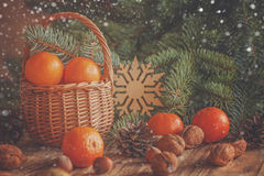 Basket with tangerines, cones, nuts and fir Royalty Free Stock Photo