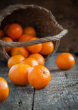 Basket and Tangerines on Wooden Background Stock Photo