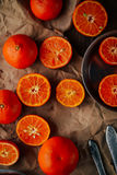 Basket of Tangerines on a wooden table.  Delicious and beautiful Stock Photos