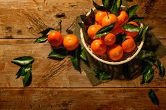 Basket with tasty tangerines Stock Photography