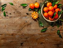Basket with tasty tangerines Stock Photos