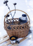 Basket with thermos of mulled wine and knitted blanket on sledge Stock Images