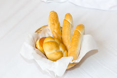 Basket with three baguettes and a donut lovely breakfast light snack of lunch on a white background Stock Photography