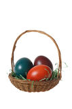 Basket with Three Colorful Easter Eggs Royalty Free Stock Images