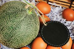 Basket to put the cantaloupe and eggs on special days. Dares to put the cantaloupe and eggs on special days stock photography