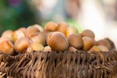 A basket of toasted hazelnuts Stock Images