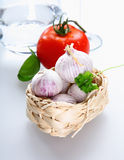 A basket with Tomato and garlic. And parsley on white background for italian concepts Royalty Free Stock Image