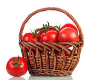 Basket with tomatoes royalty free stock image