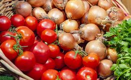 Basket with tomatoes and onions