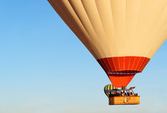 Basket with tourists of Hot air balloons flying over valley in the morning. Cappadocia. Turkey Royalty Free Stock Photo