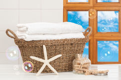 Basket Of Towels. Basket of freshly laundered towels with pegs and bubbles Stock Image