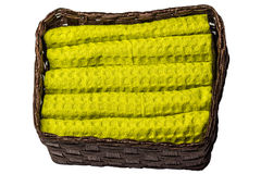 Basket with Towels. Basket containing yellow towels on white background Stock Photography
