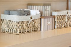 Basket of towels on wooden. In room Royalty Free Stock Image