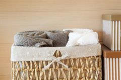 Basket of towels on wooden. In room Stock Image
