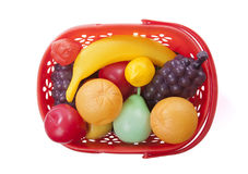Basket with toy fruits Stock Images