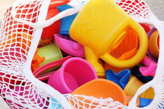 Basket of toys. A netted basket full of toys used by children for water play Royalty Free Stock Photos