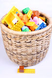 Basket with toys. Basket with plastic cubes and toys Stock Photos