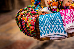 Basket of traditional dolls and mexican crafts Royalty Free Stock Images