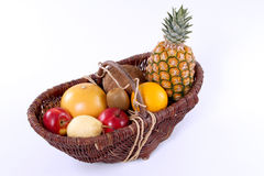 Basket of tropical fruit. On a white background Royalty Free Stock Images